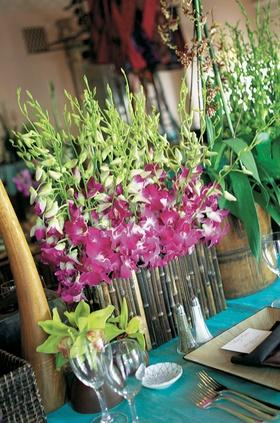 Teal tablecloths with unique floral arrangements