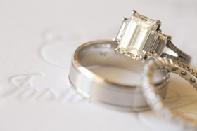 Silver wedding rings and eternity band on invite