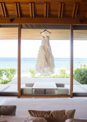 Asymmetrical wedding dress hanging in Turks and Caicos resort
