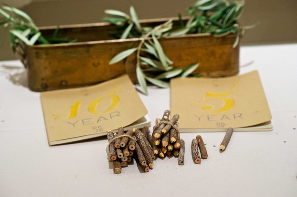 Wedding guestbook idea with 5 year and 10 year books with wood pencils