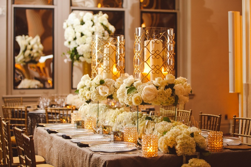 White hydrangea runner and gold-rimmed hurricanes
