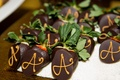 chocolate covered strawberries with a monogram or initial on it