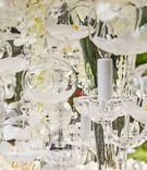 wedding centerpieces with an orchid blossom encased in glass orbs