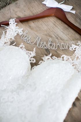 wedding dress hanger with custom name cursive white bow wood hanger