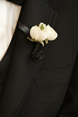 Groom's boutonniere with three white flower buds