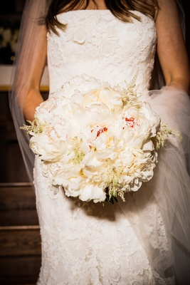 round bridal bouquet with fluffy white peonies