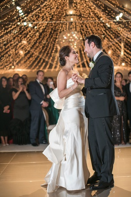 wedding reception first dance string lights tent wedding reception oscar de la renta dress