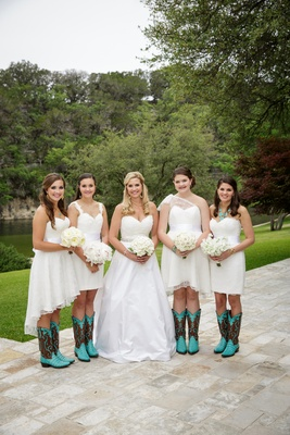 White mismatched bridesmaid dresses and cowboy boots