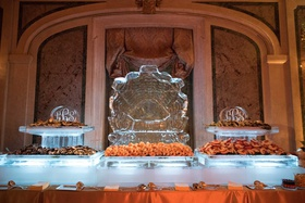 seafood station ice sculpture with monogram shrimp and other shellfish