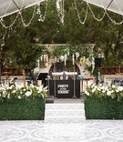 wedding reception spanish tile design on dance floor band stage greenery hedge wall white flowers