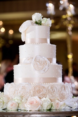 Four tier wedding cake sugar flowers pearl dots ribbon detailing fresh flowers