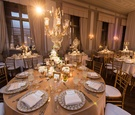 crystal chandelier with white florals on metallic tablescape