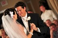 Bride and groom dancing in reception hall
