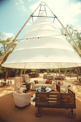 Tufted ivory wedding lounge furniture rustic wood under tipi tepee in courtyard Santa Barbara