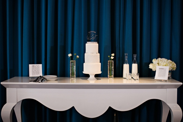 Three-tier white cake table