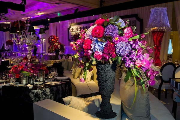 Black textured vase with bold color flowers at wedding