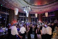guests dancing and having fun on couples excitingly lit dance floor at their reception