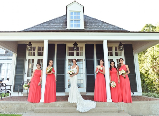 Bride in Ines Di Santo dress with coral bridesmaid dresses