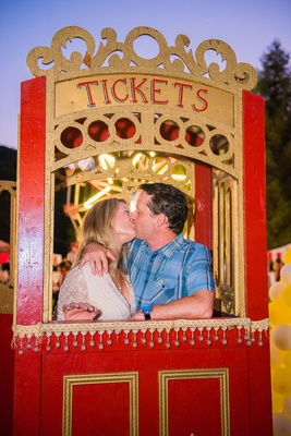 CIrcus theme wedding kissing ticket booth wedding guests cute wedding idea