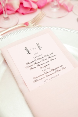 Menu stationery card with black script on pink paper