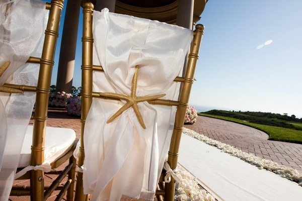 Ocean-inspired ceremony chairs in gold