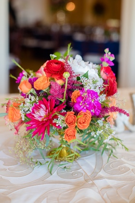 orange red pink low centerpiece spanish flair wedding southern california roses small