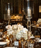 Wedding reception with modern supper club inspired design leather gold rim white orchid rose charger