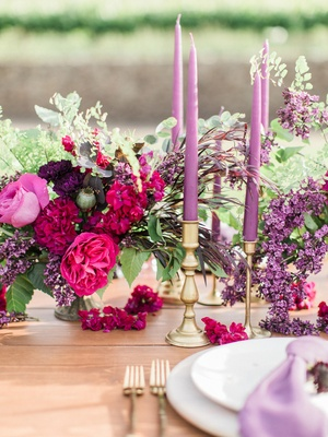 vibrant arrangement blossoms candles purple california boho chic wedding styled shoot reception