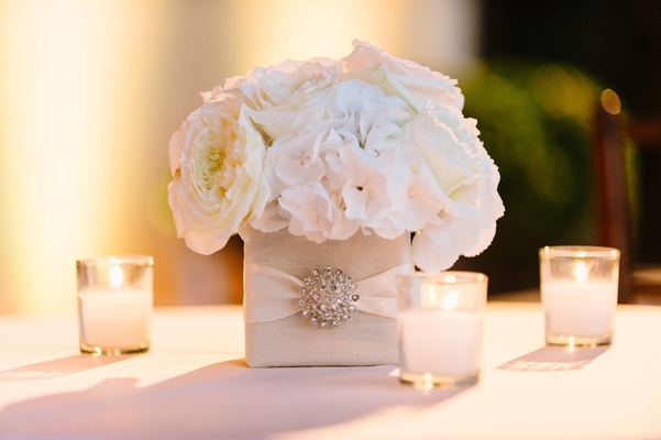 square vase with crystal embellishment, white roses and hydrangeas, votive candles