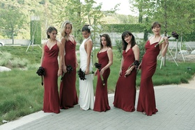 Bridesmaids with bride in slim fitting burgundy dresses