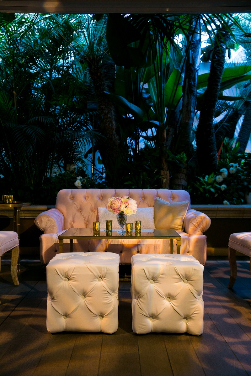 Chesterfield sofa loveseat and ottomans at outdoor reception lounge area