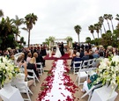 Petal-lined aisle and ivory floral arrangements