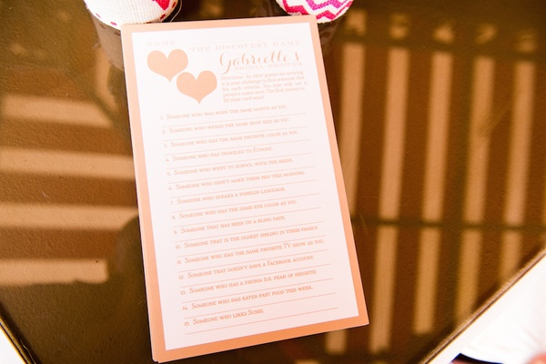 Wedding shower game card with peach border, two hearts, questions to get to know other guests