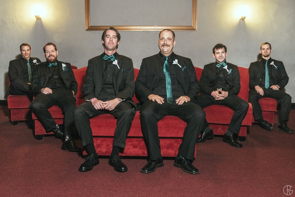 Black groomsmen outfits with teal ties and bow ties