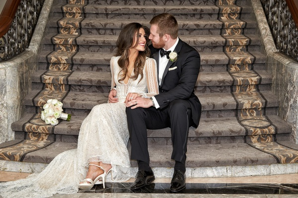 Wedding photograph Four Seasons Chicago portrait Inbal Dror wedding dress groom in tuxedo bouquet