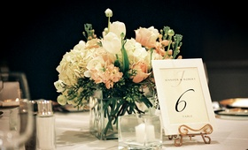 Floral centerpiece next to framed table card