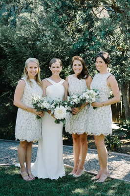 bride bridesmaids shades of white bouquets greenery flowers halter dress suzanne neville short