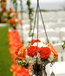 Glass vessel filled with roses and hydrangeas