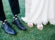 Groom's black shoes, socks with light polka dots, bride's Kate Spade shoes with bows
