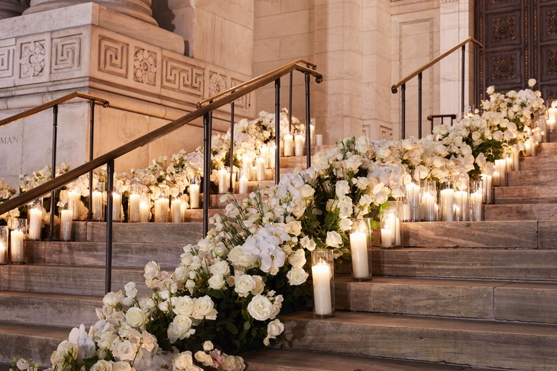 wedding at new york public library white rose flowers candles in hurricane vases outdoor staircase