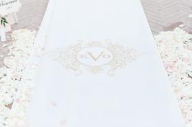 The Original Runner Company white aisle runner with gold monogram flower petals on both sides