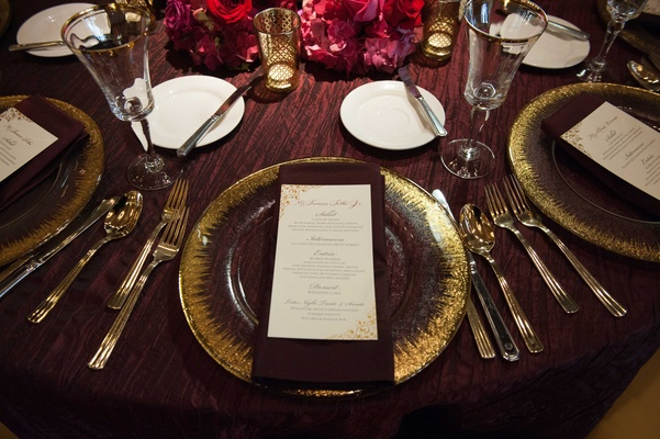 gold tableware, gold and ivory menu purple linen pink flower centerpiece