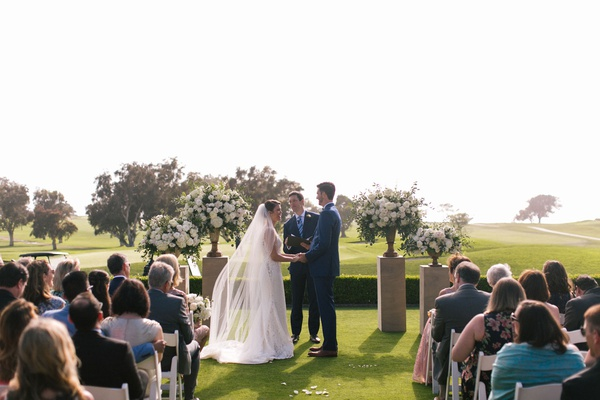bride and groom at outdoor ceremony the lodge at torrey pines friend officiating officiant guests