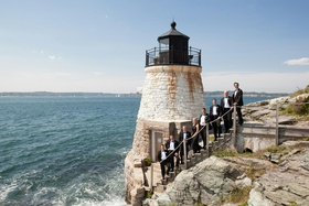 Groomsmen on steps by Rhode Island lighthouse