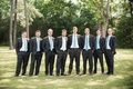 groom in charcoal suit with white tie, groomsmen in charcoal suit with tiffany blue tie