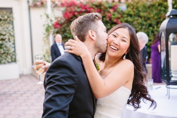 couple embraces, bride and groom at bel air bay club wedding