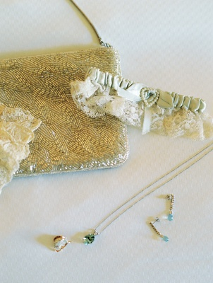 Lace leg garter with beaded clutch and blue earrings