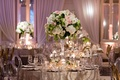 Tall centerpiece with white hydrangea green leaves pink white rose floating candles pink lighting