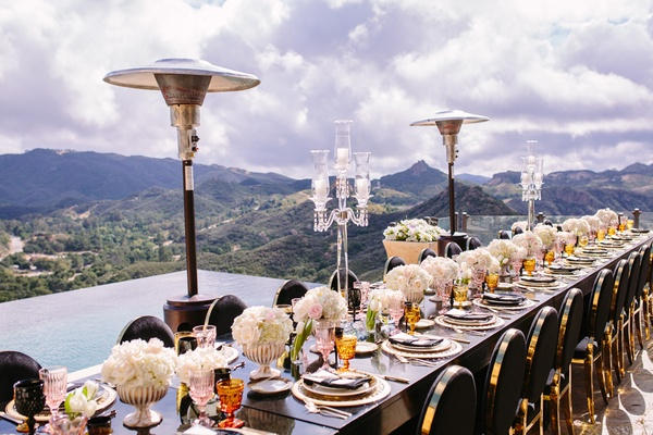 malibu rocky oaks reception, long black table with black and gold chairs, heat lamps