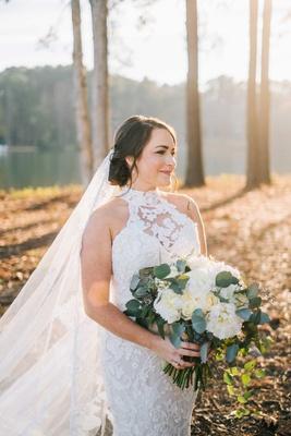bride portrait white lace mock turtleneck wedding dress lace cathedral veil hair up winter wedding